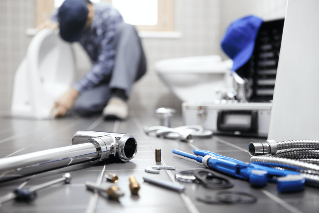 plumber-near-me-plumber-background-tools-foreground-min